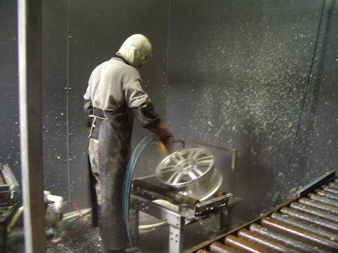 remove paint: powder and excess coating from recessed areas on the aluminum wheel surface